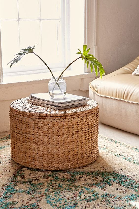 such a wicker coffee table and ottoman features a storage space inside and is great for many living rooms