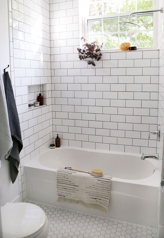 white tiles - subway ones on the walls and hex penny tiles on the floor for a soothing and calming look