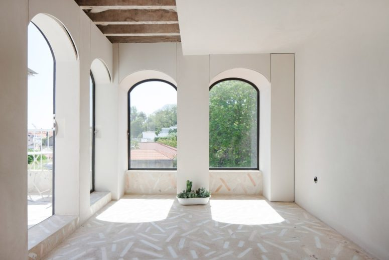 The adorable arched windows were highlighted with black frames and look at those mosaic floors - aren't they amazing