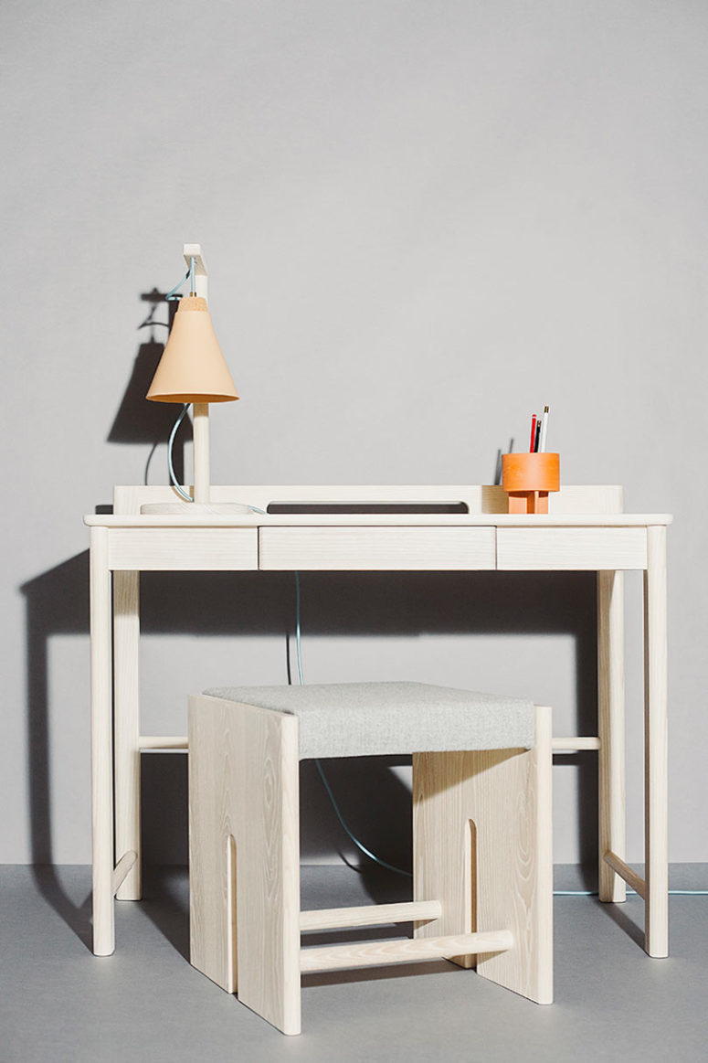 The desk and the stool are more minimalist, with the same curved angles on the desk and a hidden drawer for storage