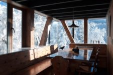 03 The dining space is fully of wood and there are non-framed windows to catch the views while eating here
