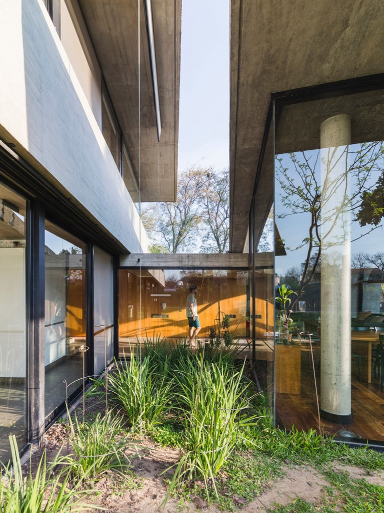 The house includes two separate volumes, which are connected with each other and contain different spaces