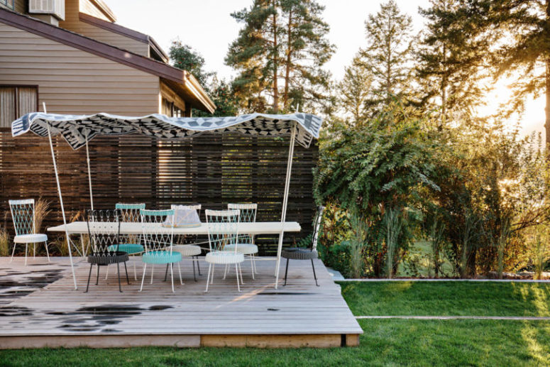 There's a comfy outdoor deck with a dining space to enjoy a fresh air and outdoor living