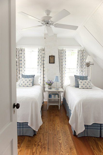 a chic vintage bedroom with two beds, two windows, much pattern and neutral for a soothing feel
