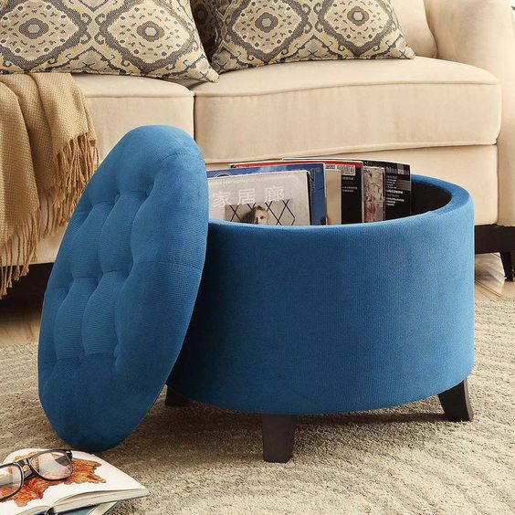 an upholstered storage ottoman can double as a coffee table and is a smart option for a contemporary space