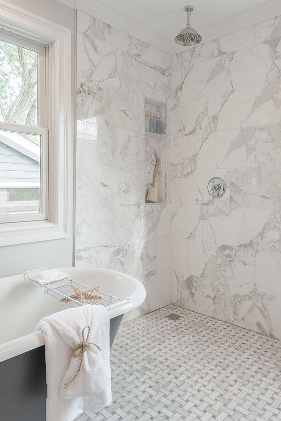 white marble tiles - graphic ones on the floor and square ones on the walls create a harmonious and cohesive space