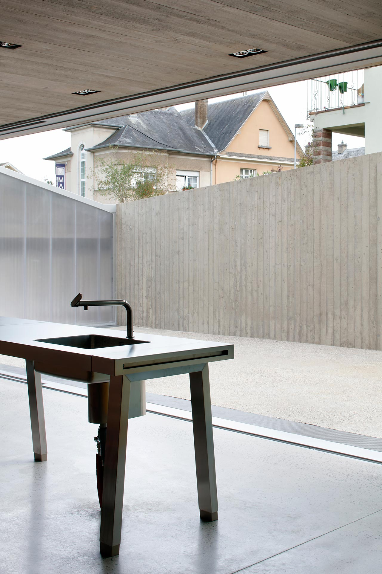 The kitchen island is minimalist and stripped down to minimal