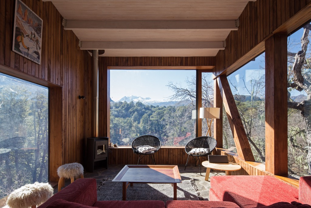 The living rooms also feature several panoramic windows to enjoy the mountains and comfy furniture plus a hearth