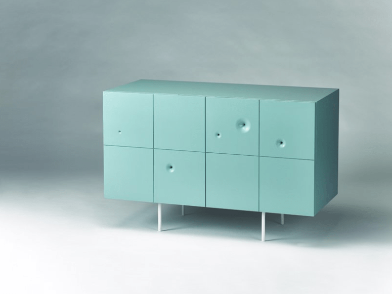This is an aqua-colored cabinet of birch plywood, with severla wormholes
