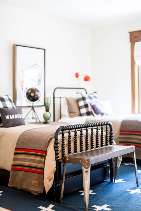 a colorful guest bedroom with two beds, various textiles and catchy lamps and accessories