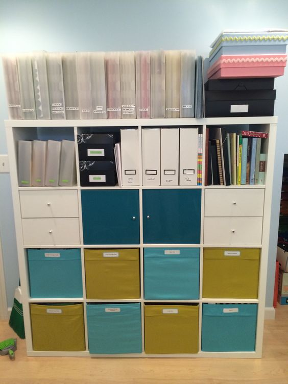 a home work station of an IKEA Kallax finished off with colorful IKEA Drona boxes is a cool storage idea for your home
