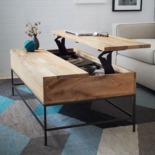 a minimalist coffee table that can be transformed into a desk or dining table easily and features storage