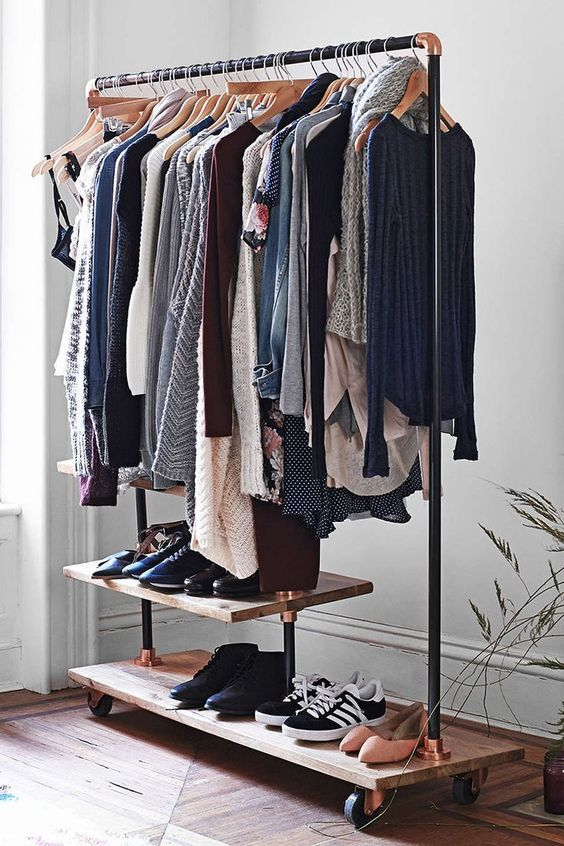 place an open storage rack for hanging clothes and placing shoes for your guests