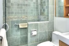 04 the same green color and different sizes of tiles with white grout for a relaxing and soothing little bathroom