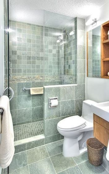 the same green color and different sizes of tiles with white grout for a relaxing and soothing little bathroom