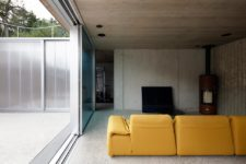 05 A bright sofa, a TV and a hearth are all the furniture you'll see in the living space