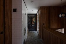 05 Brick and stone are featured in the interiors, too, to make the cabin feel like cabin