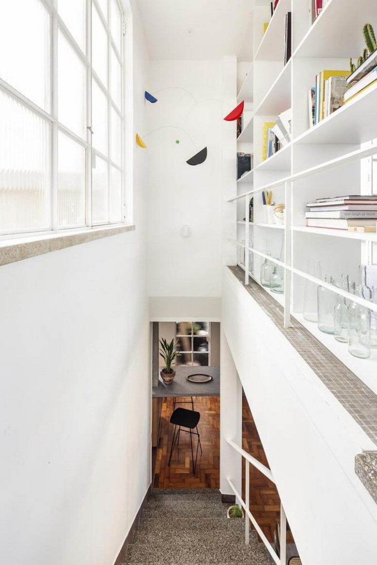 Each inch of space is taken to use it - there is a storage unit over the staircase