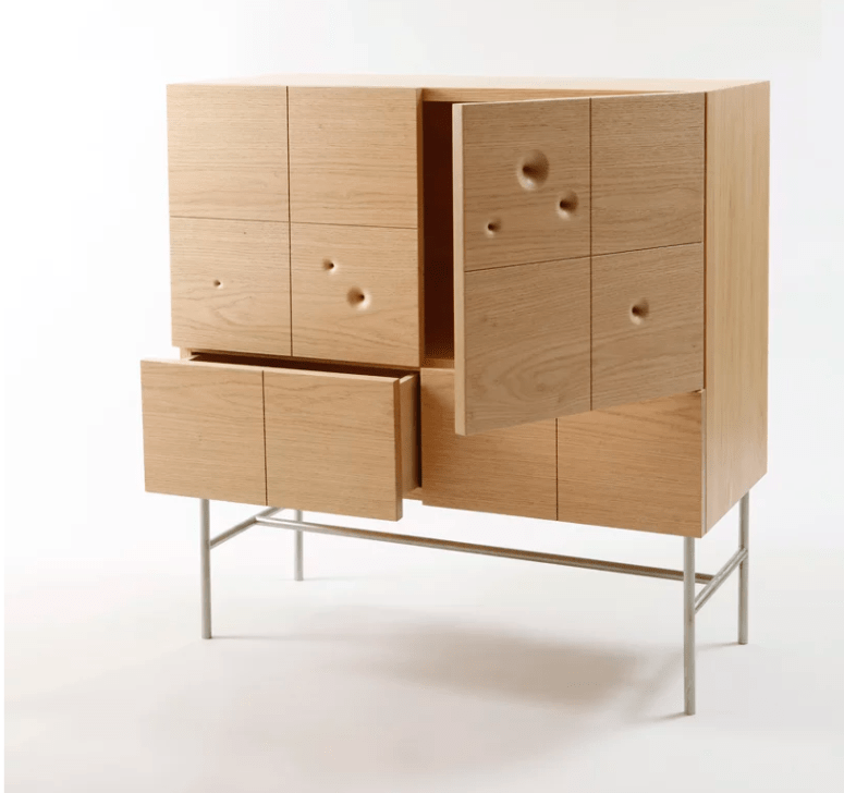 The cabinet of red oak and stainless steel is a unique storage piece