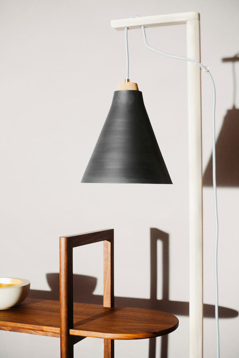 The floor or table lamp from the collection features raw and minimalist easthetic