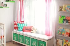 05 a colorful upholstered bench with numbered Drona boxes is a nice DIY for a nursery