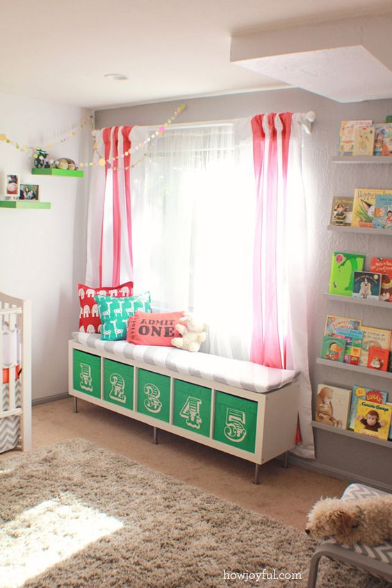 a colorful upholstered bench with numbered Drona boxes is a nice DIY for a nursery