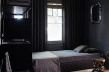05 a comfy moody bedroom with layered rugs, thick curtains and dark bedding for winter