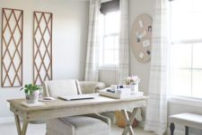 05 a neutral home office with whitewashed wood, various prints and lots of natural light