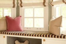05 an upholstered windowsill bench with some built-in storage and a comfy pet niche with toys