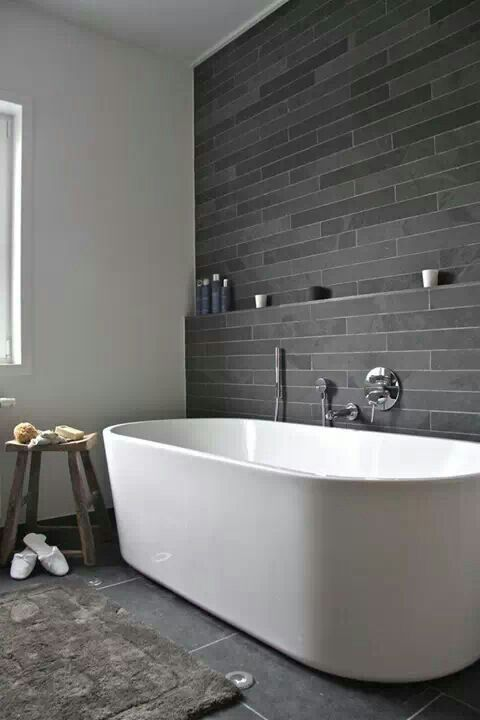 same grey stone tiles   longer and narrow ones on the walls and large ones on the floor