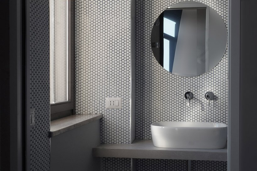 contemporary bathroom design with cool penny tiles