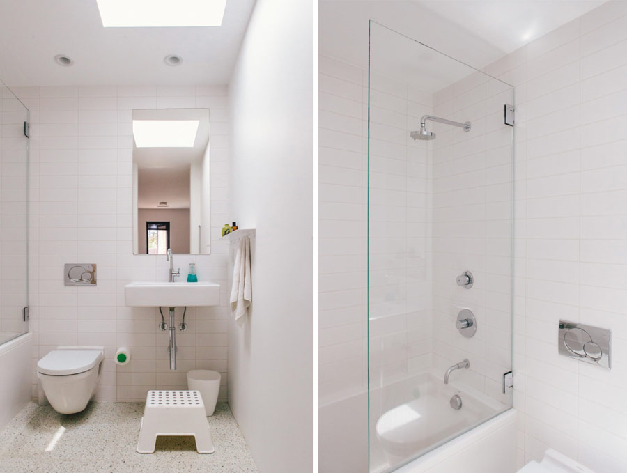 The bathroom is done in white, too, and the floor features a pattern, colorful touches add interest