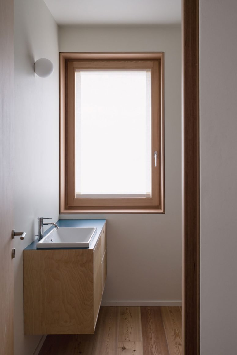 The bathrooms also feature windows that fill the space with natural light but the window is frosted