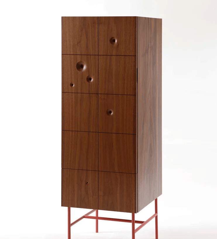 There's also a tall cabinet with several wormhole