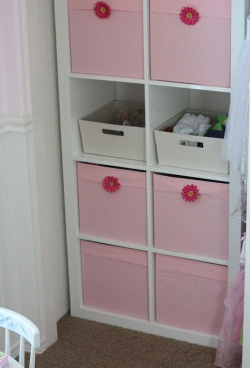 a comfy storage unit with open and closed storage done with pink Drona boxes with flowers