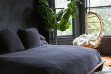 06 a dark bedroom is filled with natural light, styled with dark bedding and neutral textiles