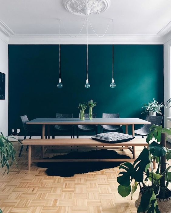 a dark green statement wall is a cool idea to update your dining room done in neutrals