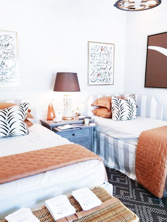 a fashion-inspired guest bedroom with touches of rust and chocolate brown looks very fresh and inspiring