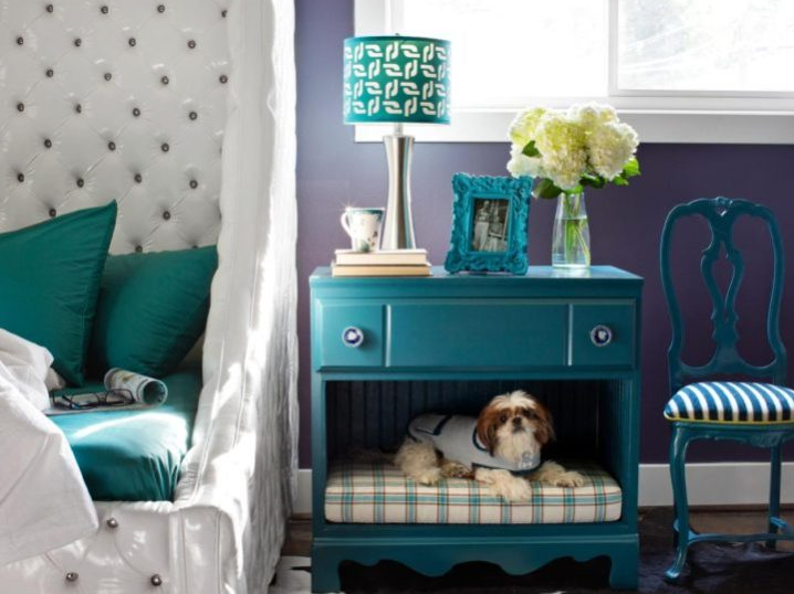 a vintage dresser and bedside table with a dog space added in the lower part of it