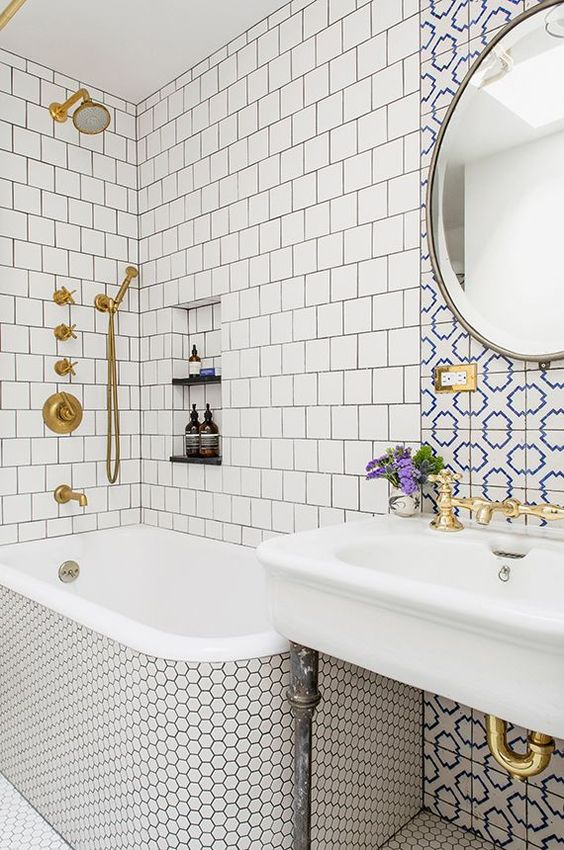 neutral tiles   square ones and penny hex tiles plus an accent with blue and white mosaic tiles over the sink