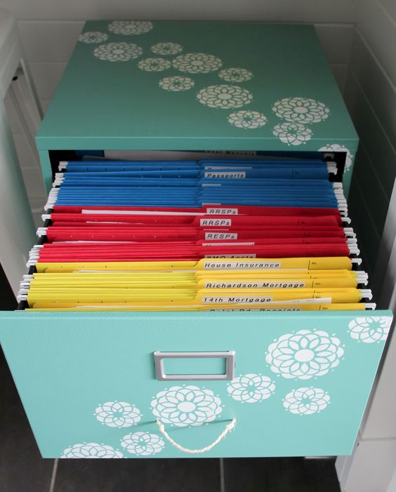 organizing paperwork with a colour coded file system will help you tackle paper clutter