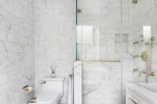 07 Carrara marble tiles on the walls and floor, smaller ones and larger ones on the floor for a neutral look