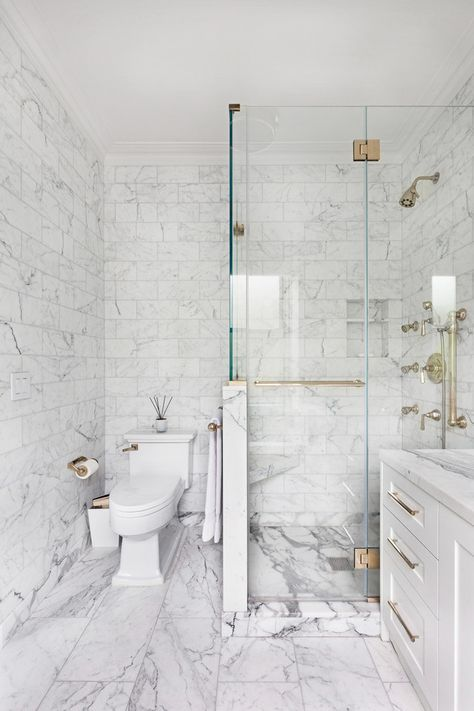 Carrara marble tiles on the walls and floor, smaller ones and larger ones on the floor for a neutral look