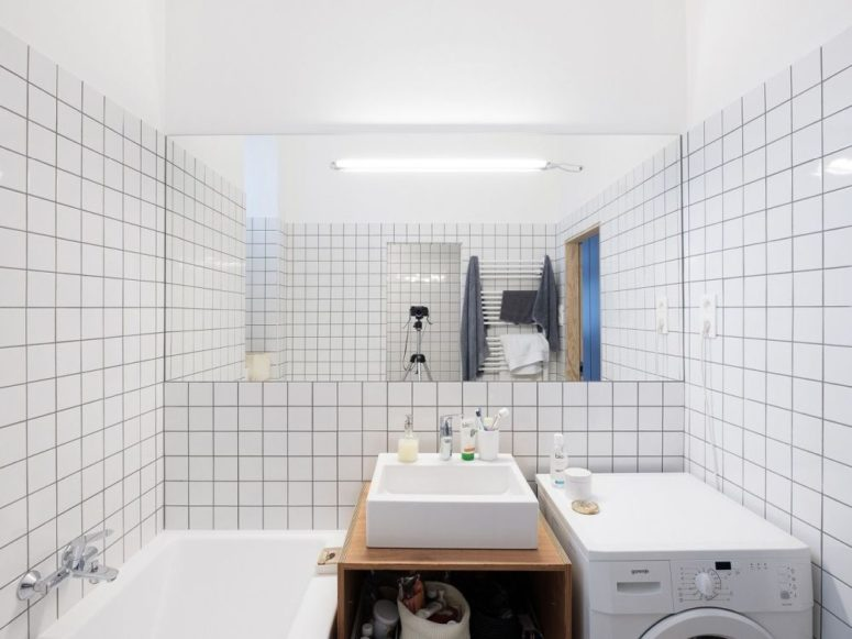 The bathroom is done with white subway tiles, black grout, there's everything necessary here