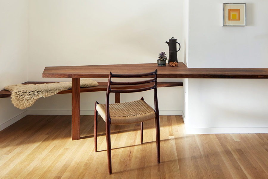 The desk can be also used as a breakfast space, there's a floating bench by it