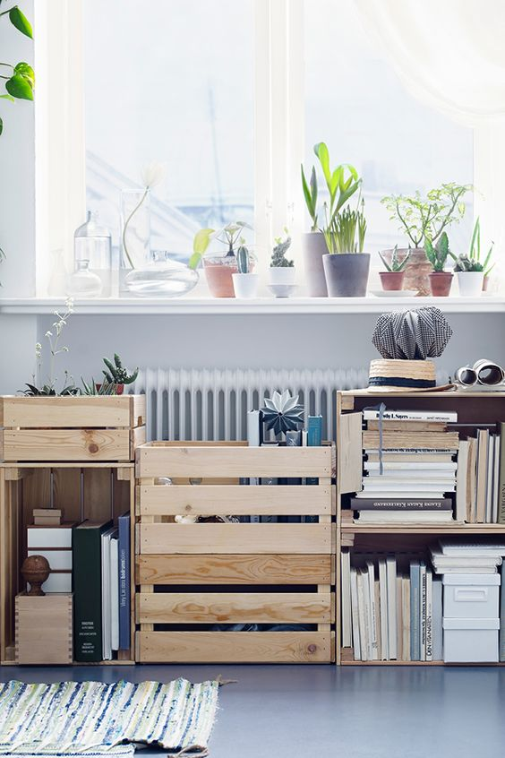 a large shelving unit made of several IKEA Knagglig boxes is a great storage piece for a contemproary space
