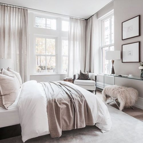 a neutral bedroom with touches of blush and dusty pink to make it catchy and add a girlish feel