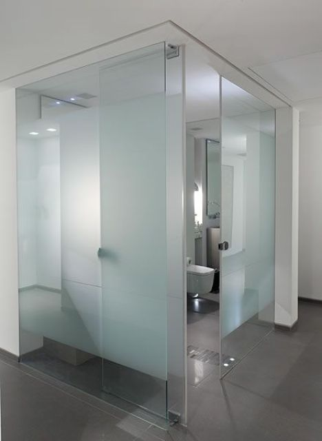a powder room all clad with frosted glass is a very contemporary and fresh idea for a minimalist space