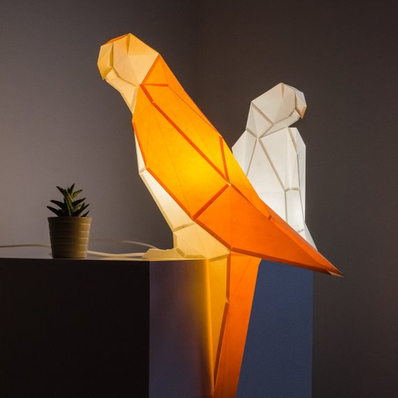 A couple of geometric parrots will fill your space with light and look catchy