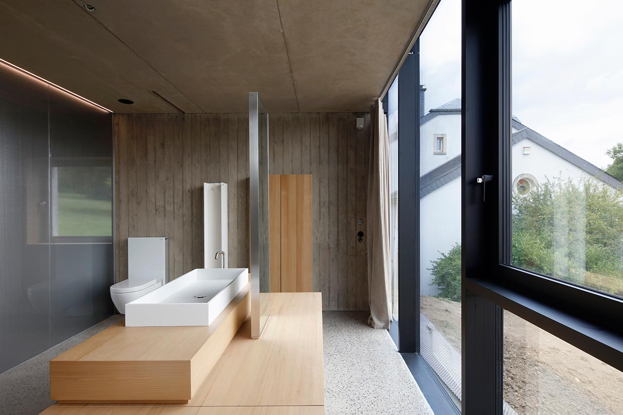 The bathroom is a spacious one, with a glazed wall, which is opaque from the outside